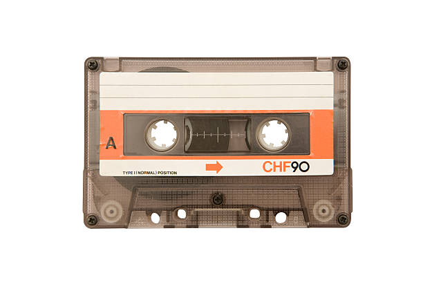 Old Audio Cassette (Clipping Path Included) Run-down audio tape isolated on a white background. Clipping path included. audio cassette stock pictures, royalty-free photos & images