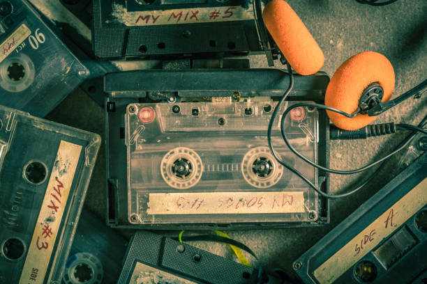 Old audio cassette with headphones and walkman stock photo