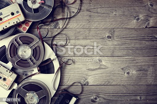 istock Old audio reels and cassette tape background 853911574