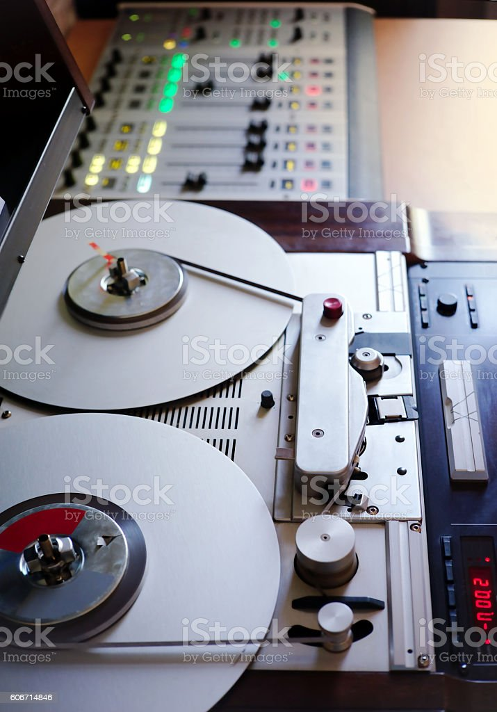 Old tape recorder and audio equipment close up.