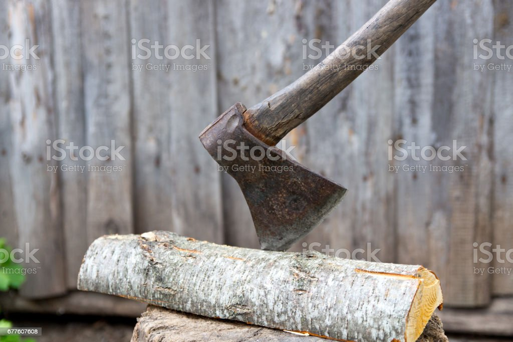 Old axe on a tree stump for chopping firewood. royalty-free stock photo