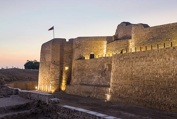 Old Bahrain Fort at Seef at sunset stock photo