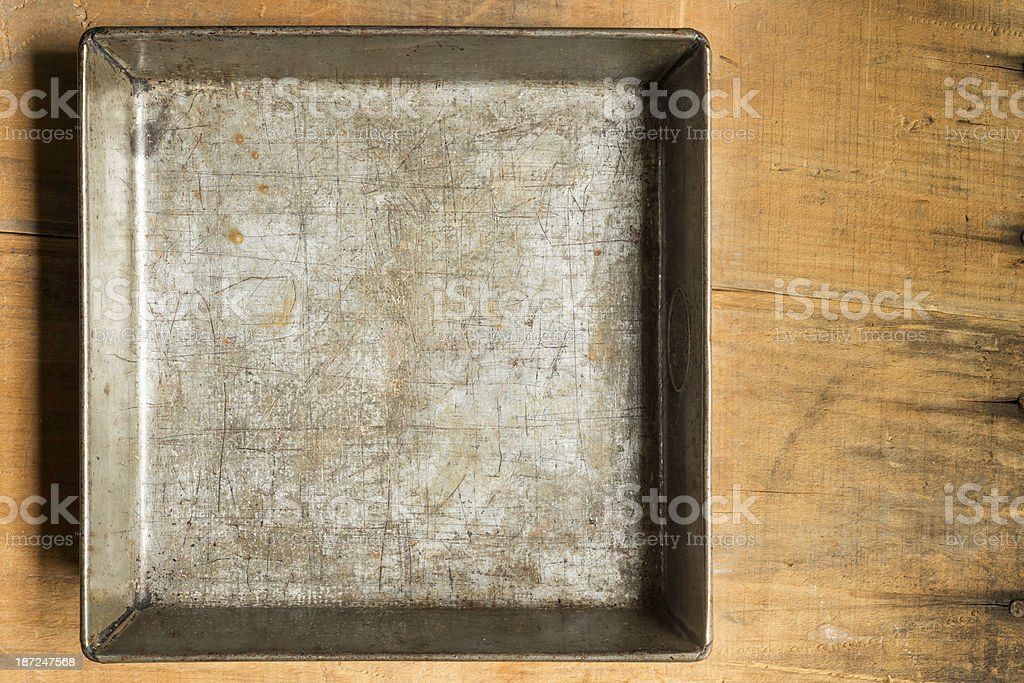 Old Baking Pan on a Wooden Crate with Copy Space stock photo