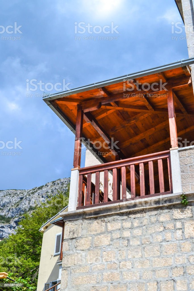 Old balcon on the old house, view from below stock photo