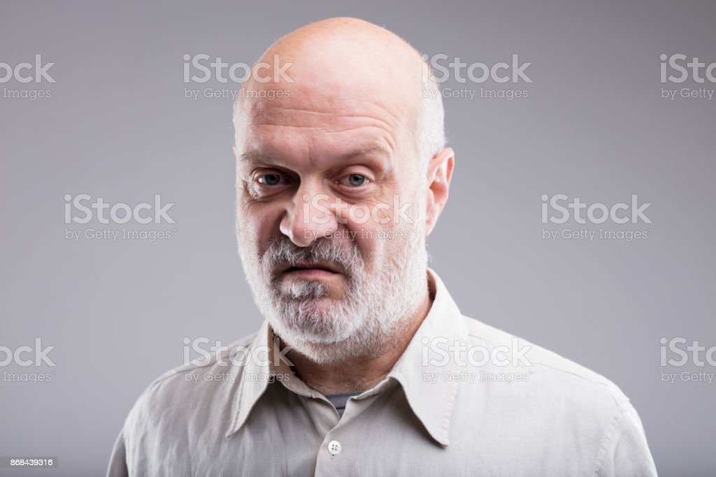 old bald man disgusted and disappointed stock photo