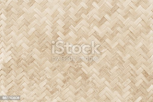 istock Old bamboo weaving pattern, woven rattan mat texture for background and design art work. 882763608
