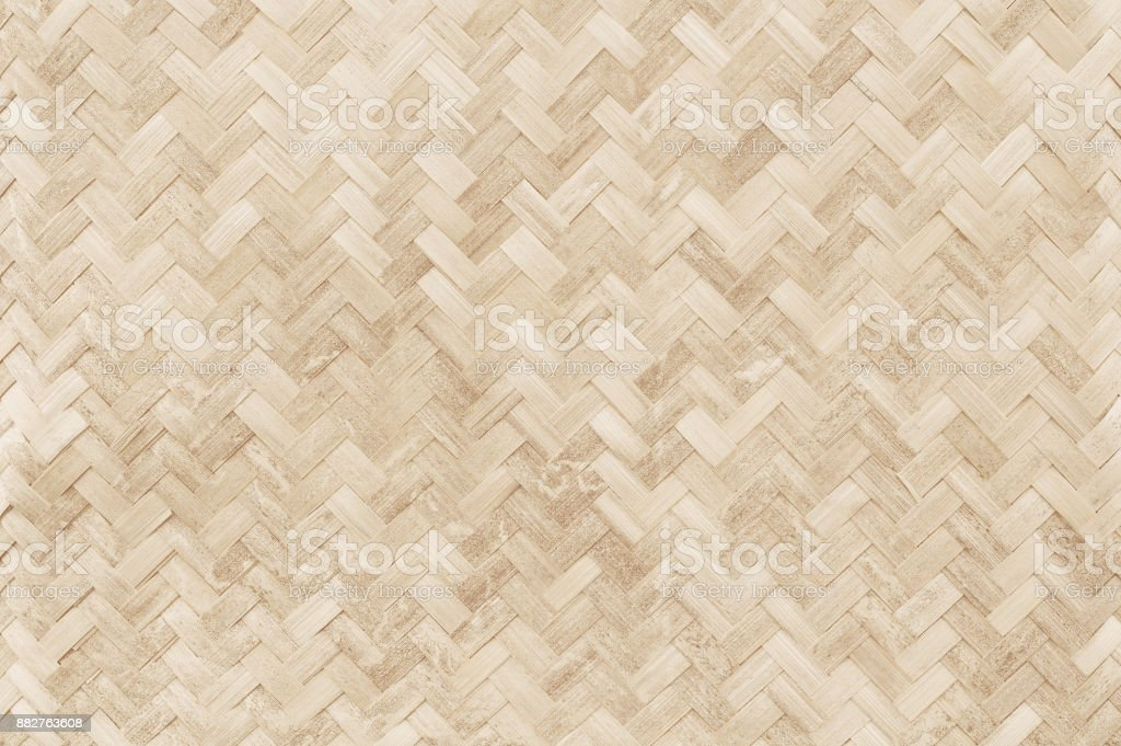 Old bamboo weaving pattern, woven rattan mat texture for background and design art work. stock photo