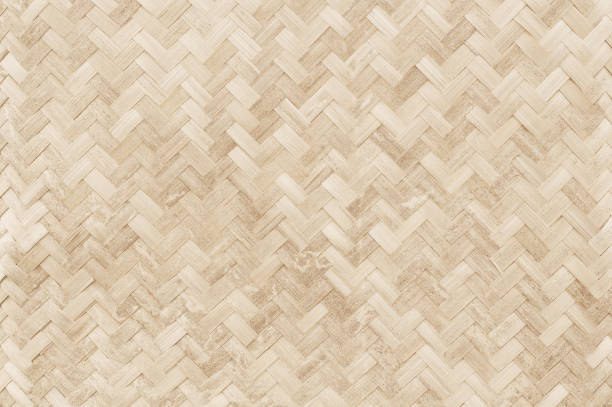 Old bamboo weaving pattern, woven rattan mat texture for background and design art work. Old bamboo weaving pattern, woven rattan mat texture for background and design art work. wicker stock pictures, royalty-free photos & images
