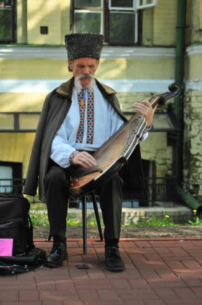 Cтоковое фото Old bandura player on the street