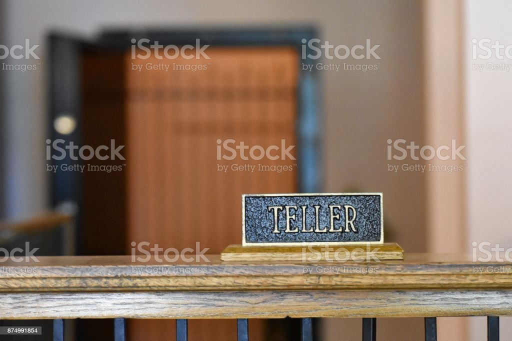 Old bank teller sign stock photo