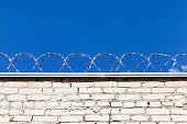 istock Old barbed wires 1003512784