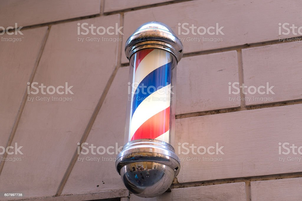 Old barber shop pole stock photo