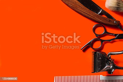 834518170 istock photo Old barber tools on an old beautiful Lush Lava surface. A razor, shaving brush, comb, hairdressers scissors, and a clipper. horizontal orientation. copy space 1204866530