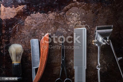 1126324804 istock photo Old barber tools on an old beautiful rusty surface. 1186163910