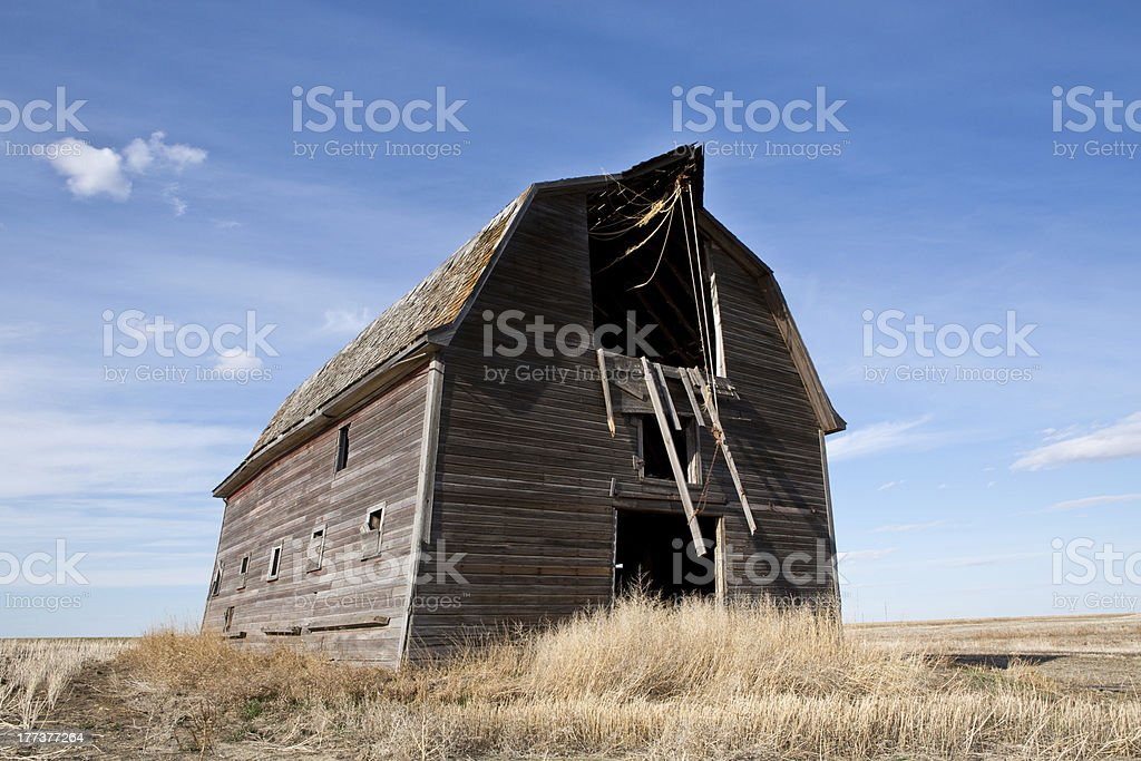 Old barn against blue sky on the prairie royalty-free stock photo