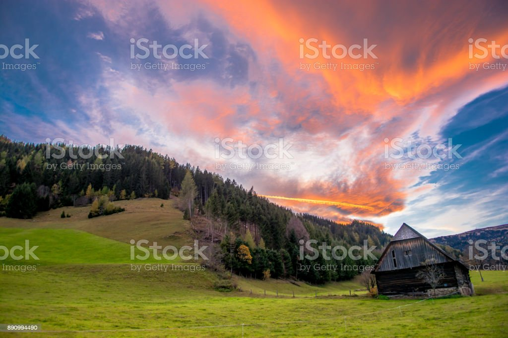 Old Barn At Sunset With Clouds stock photo
