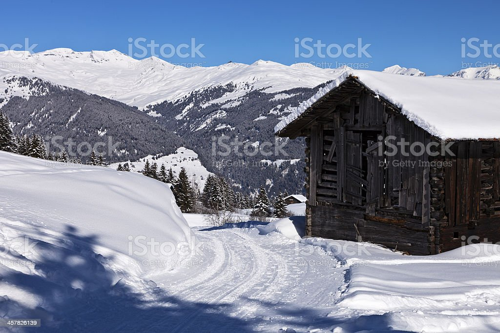 Old Barn by Road in Winter stock photo