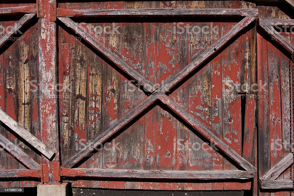 Old Barn Door with Fading Red Paint stock photo
