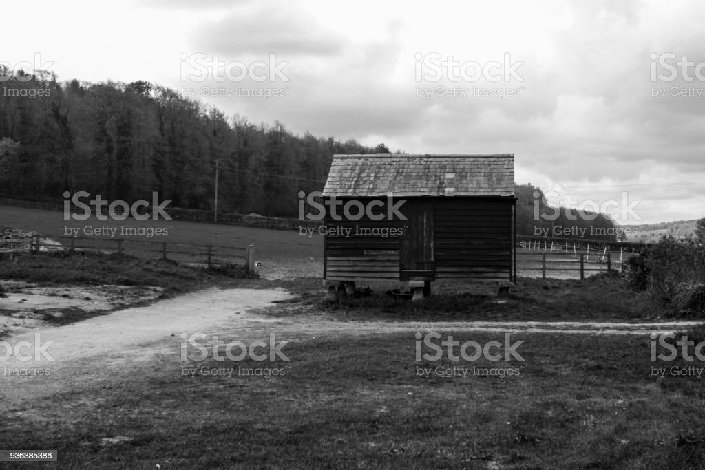Old barn in the hills stock photo