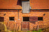 vintage barn made of red bricks in a rural landscape
