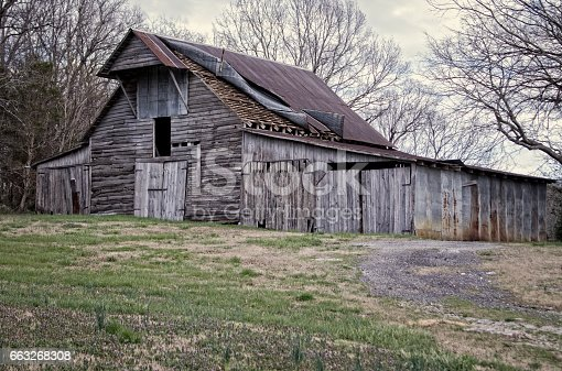 Old faded wood banr used to store equipment and feed.