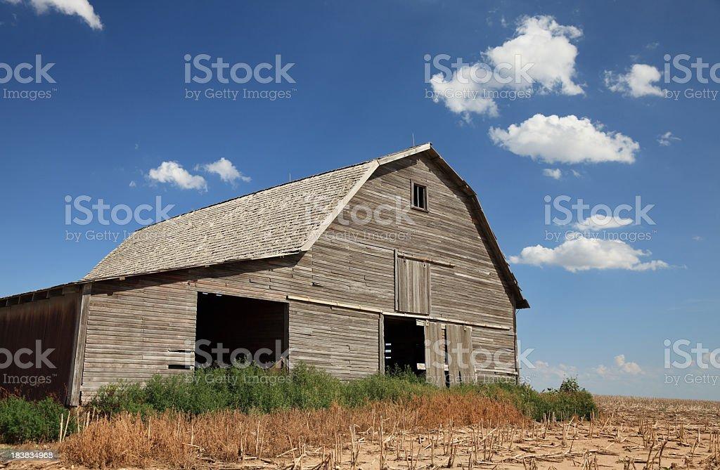 Old barn plowed field blue sky royalty-free stock photo
