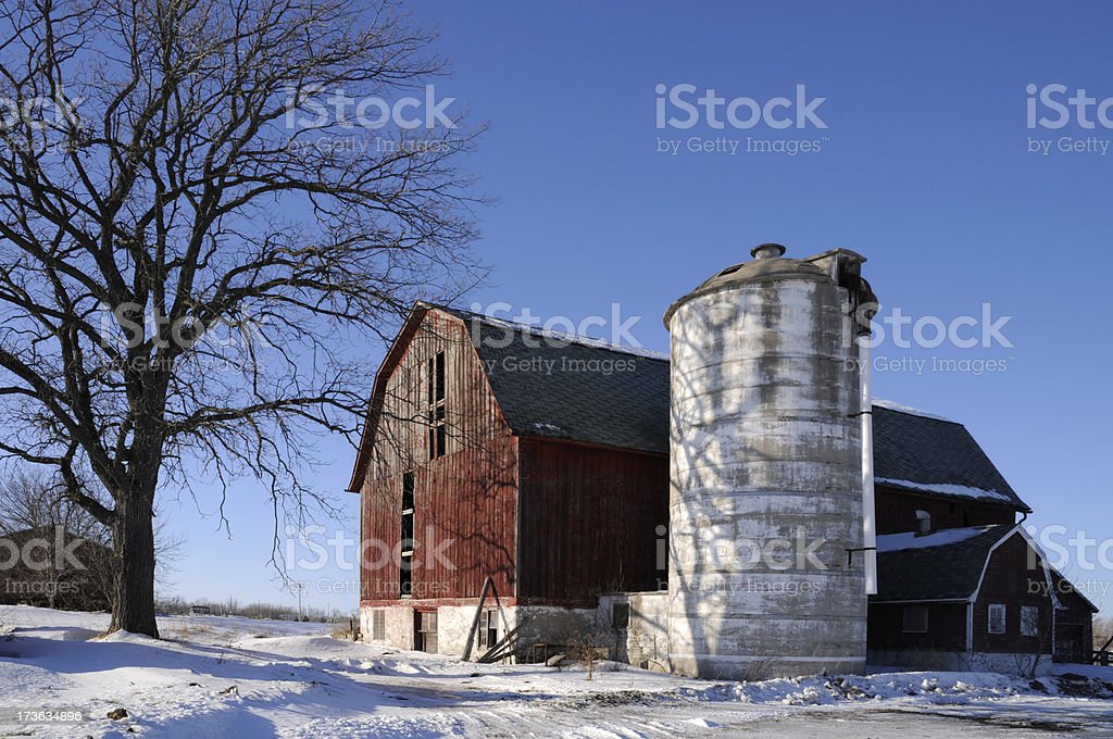 Old Barn With Silo and Shadows royalty-free stock photo