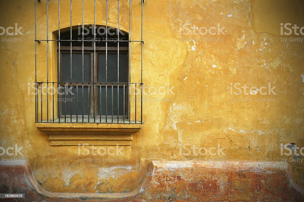 Old Barred Window and Wall in Antigua, Guatemala royalty-free stock photo