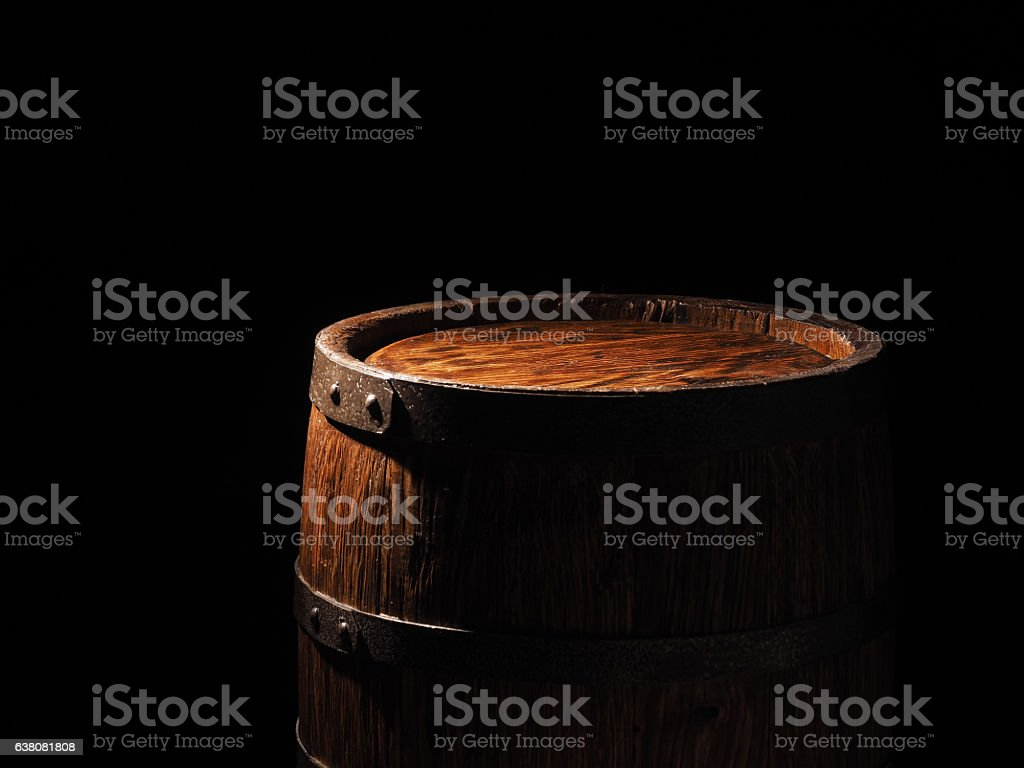 Old barrel with cognac on wooden backgroun stock photo