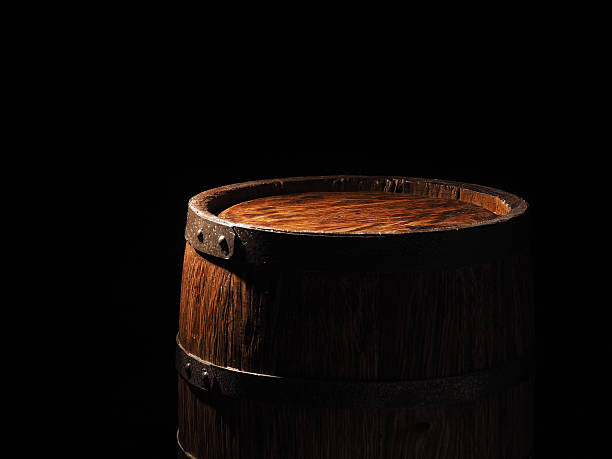 Old barrel with cognac on wooden backgroun - foto de acervo