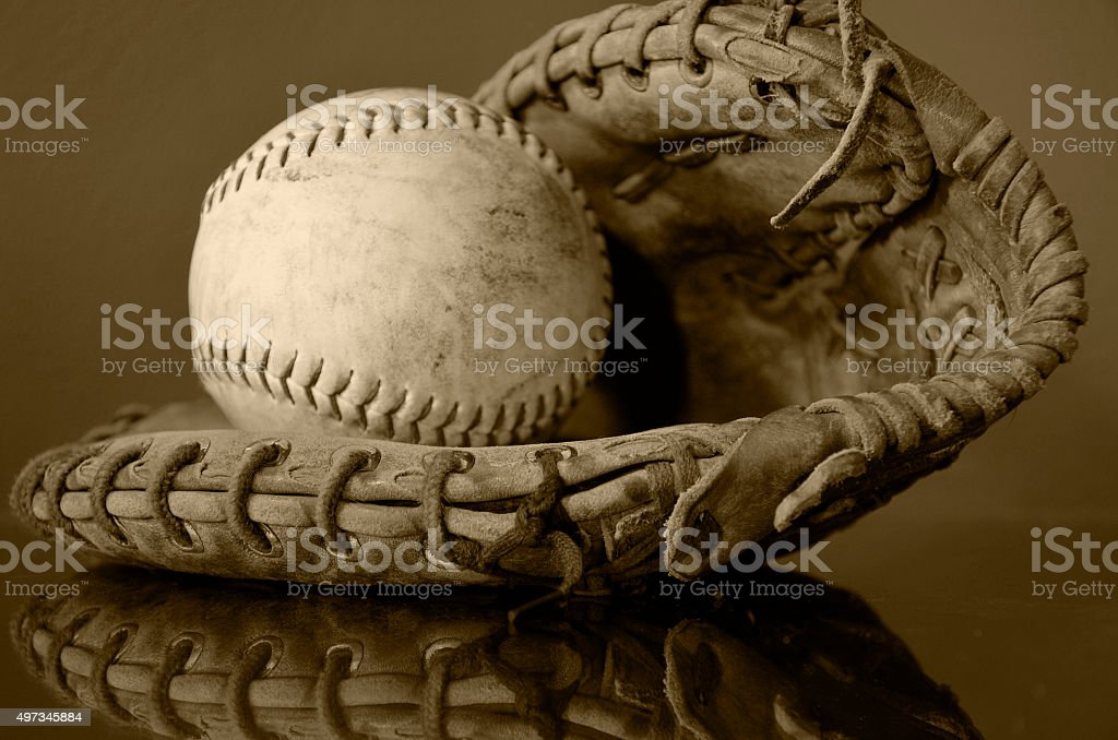 Old Baseball and Baseball Glove stock photo