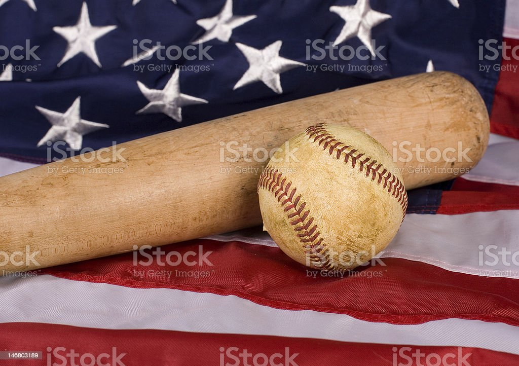 Old Baseball and Bat with American Flag royalty-free stock photo