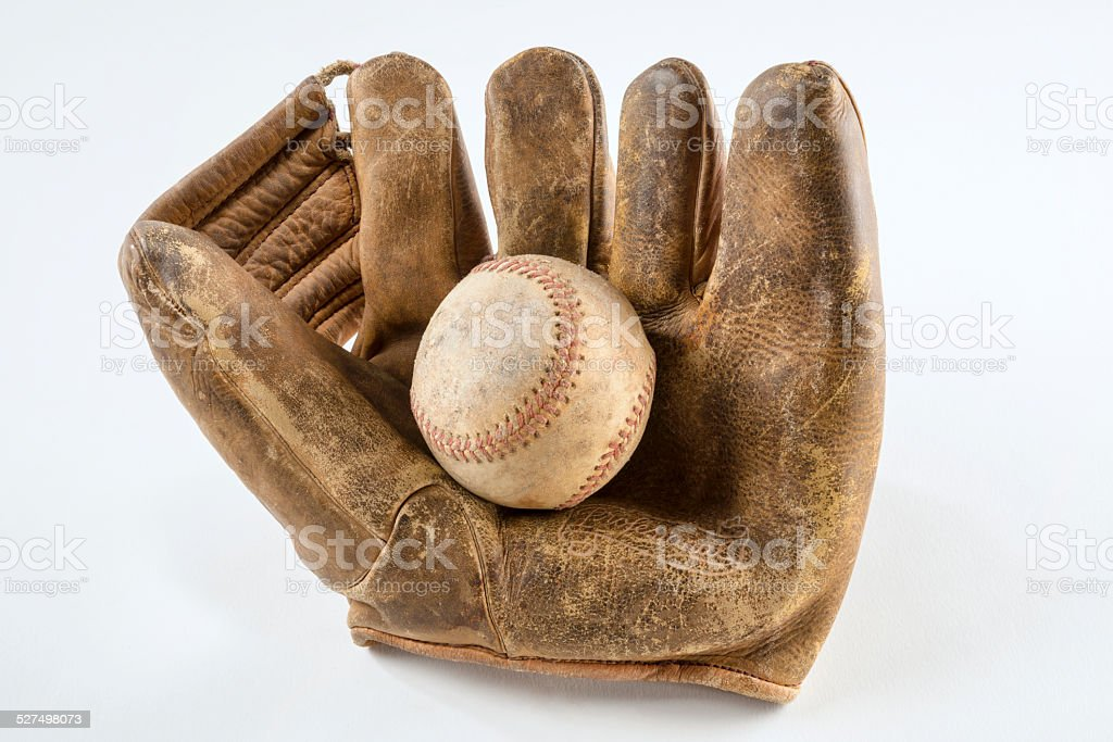 Old baseball glove and ball stock photo