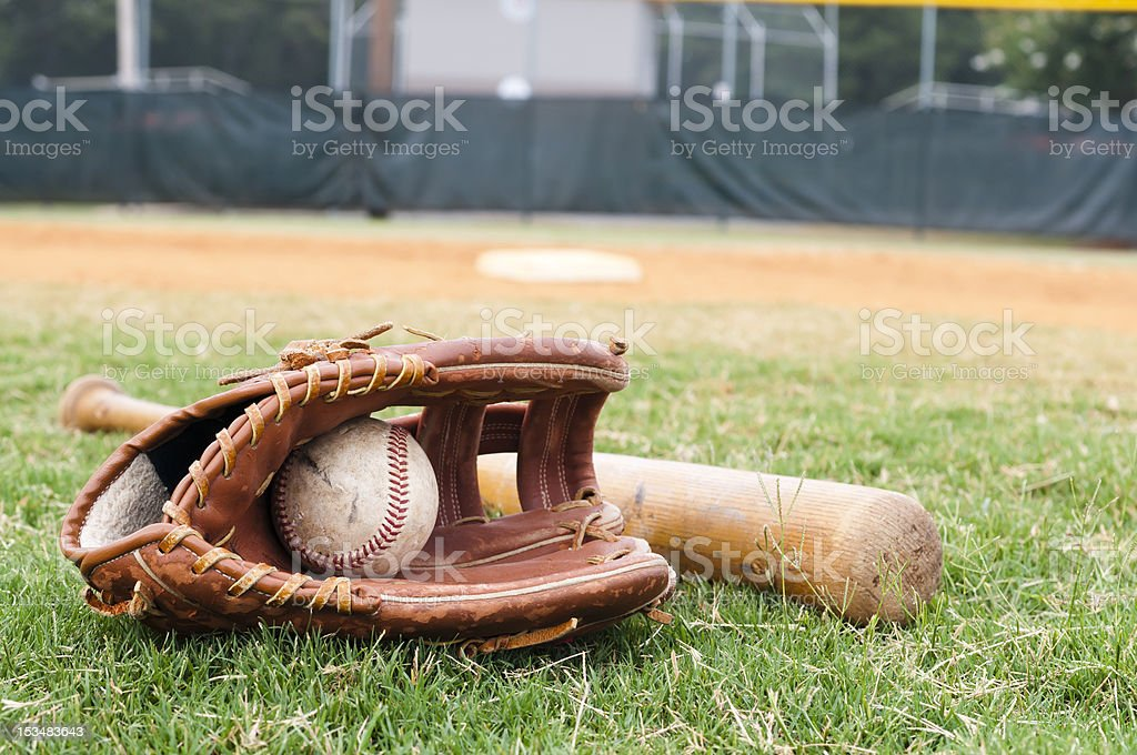 Old Baseball, Glove, and Bat on Field stock photo