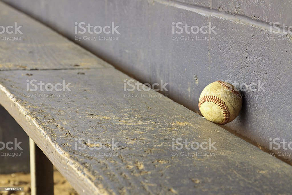 Old Baseball On Dugout Bench stock photo