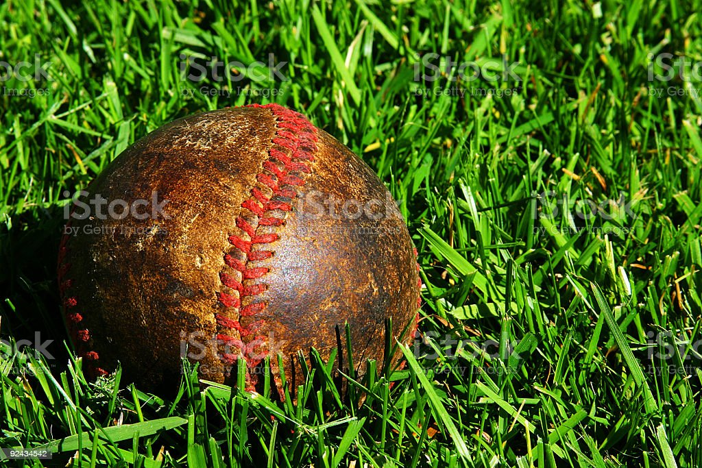 Old Baseball on Grass royalty-free stock photo