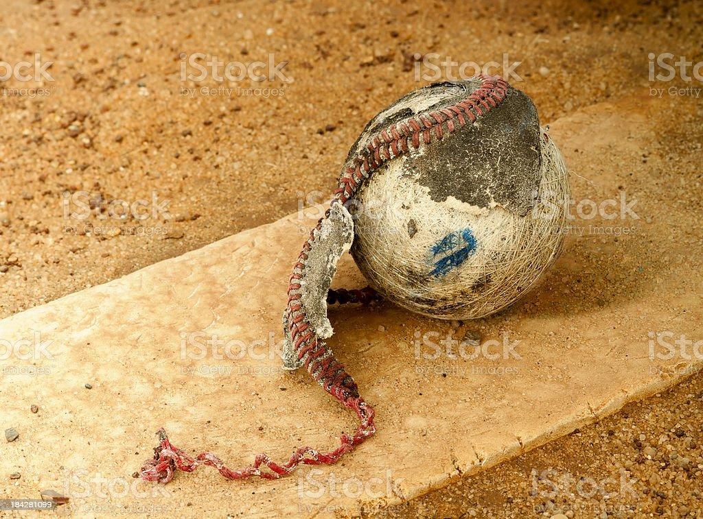 Old baseball on the mound stock photo