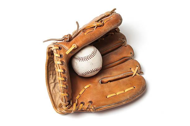 Old baseball with a baseball glove stock photo