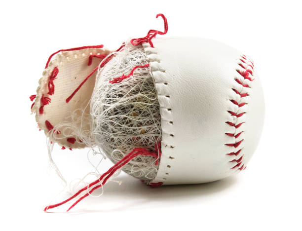 Old baseball with red strings stock photo