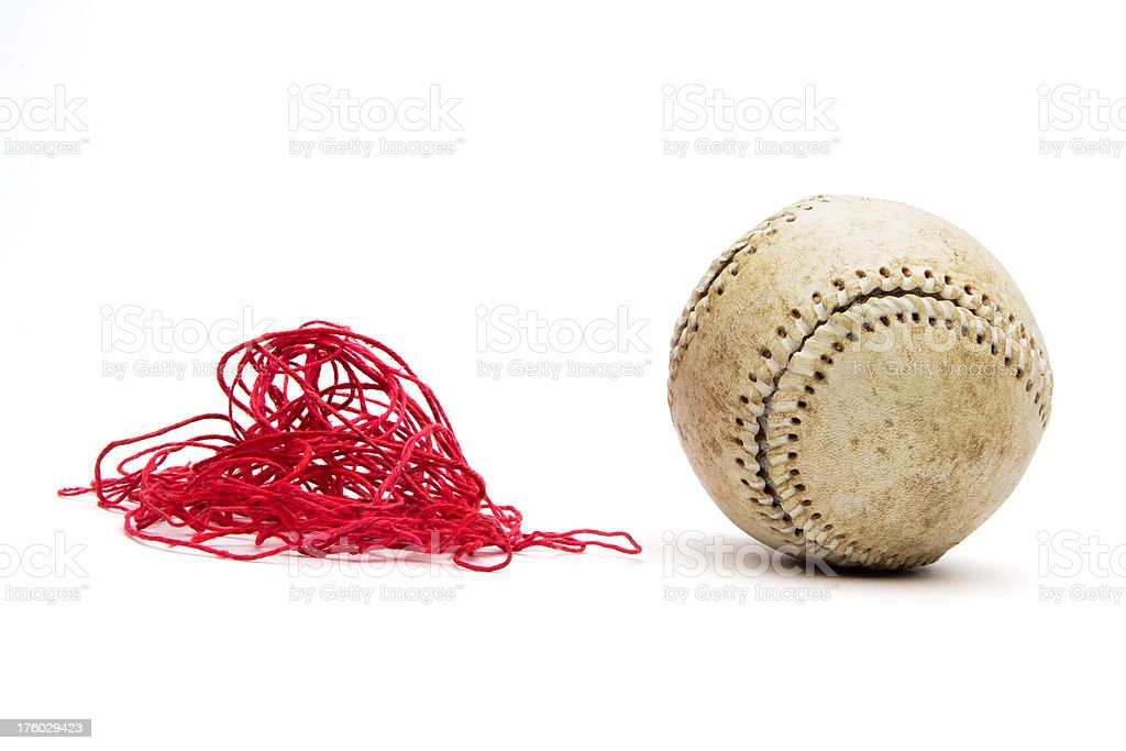 Old baseball with stitching threads removed and next to ball stock photo