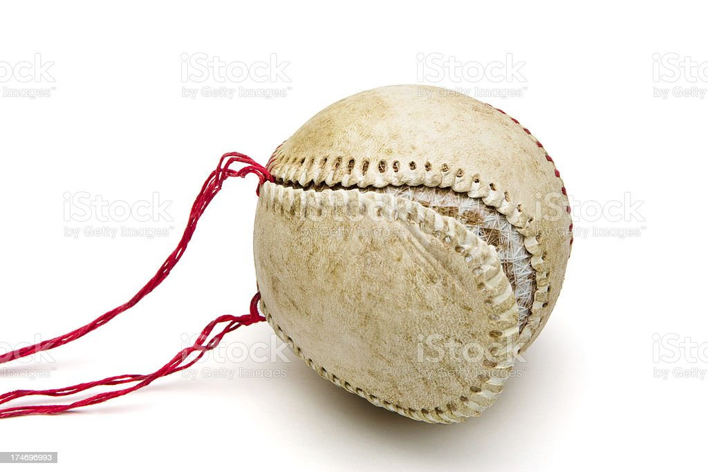 Old baseball with unstitched seams and loose cover stock photo