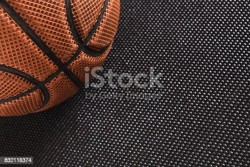 istock Old basketball ball on black background copy space 832116374