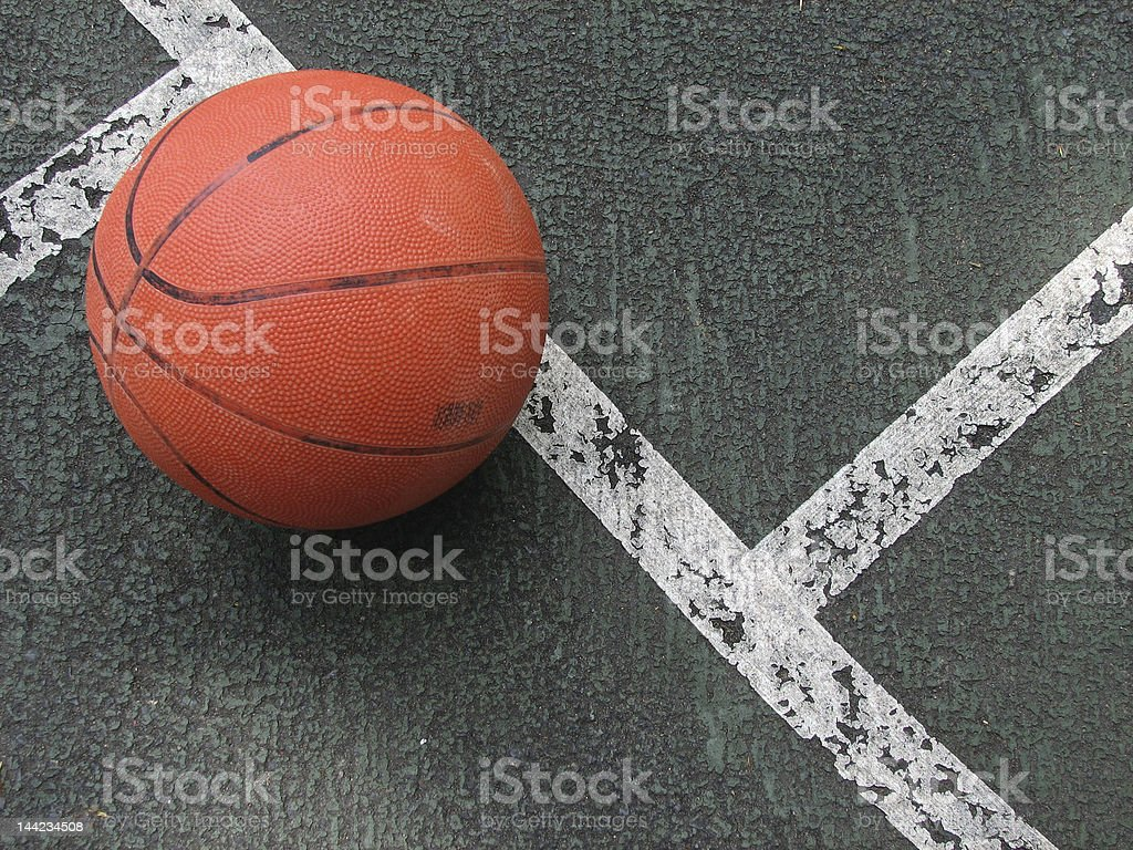 Old Basketball on Worn Court stock photo
