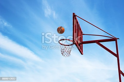 istock Old Basketball ring on blue sky 899910832