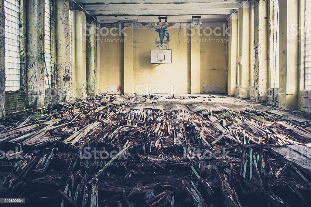 old basketball sports court, abandoned school gym stock photo