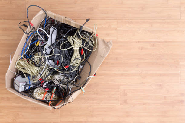 Old battered box with electrical cords stock photo