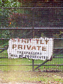 istock old battered worn and weathered strictly private trespassers will be prosecuted sign 857988232