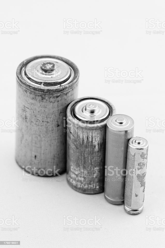 Old batteries on white background stock photo