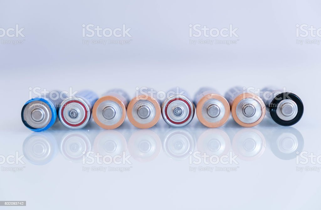 old battery was leaking, hazardous waste. abstract background of colorful batteries. . Alkaline battery aa size. Group of used disposable drain batteries of various size ready for recycling. stock photo