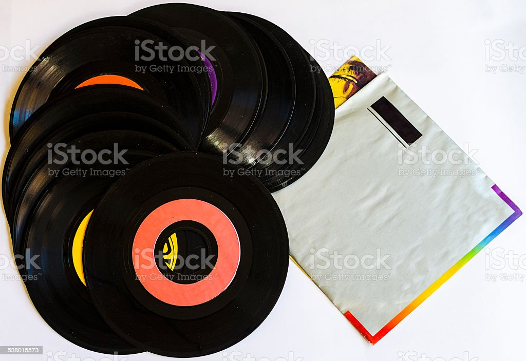 Old beat up 45s and their paper sleeves stock photo